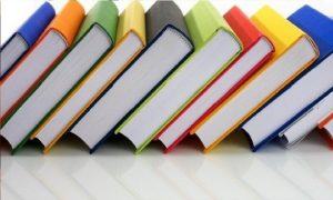 A picture of colorful books on a table