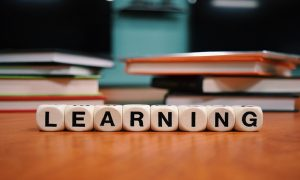"""Photo of letter cubes spelling out """"Learning"""""""